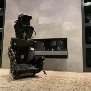 A Martin Baker ejection seat in front of a fireplace.