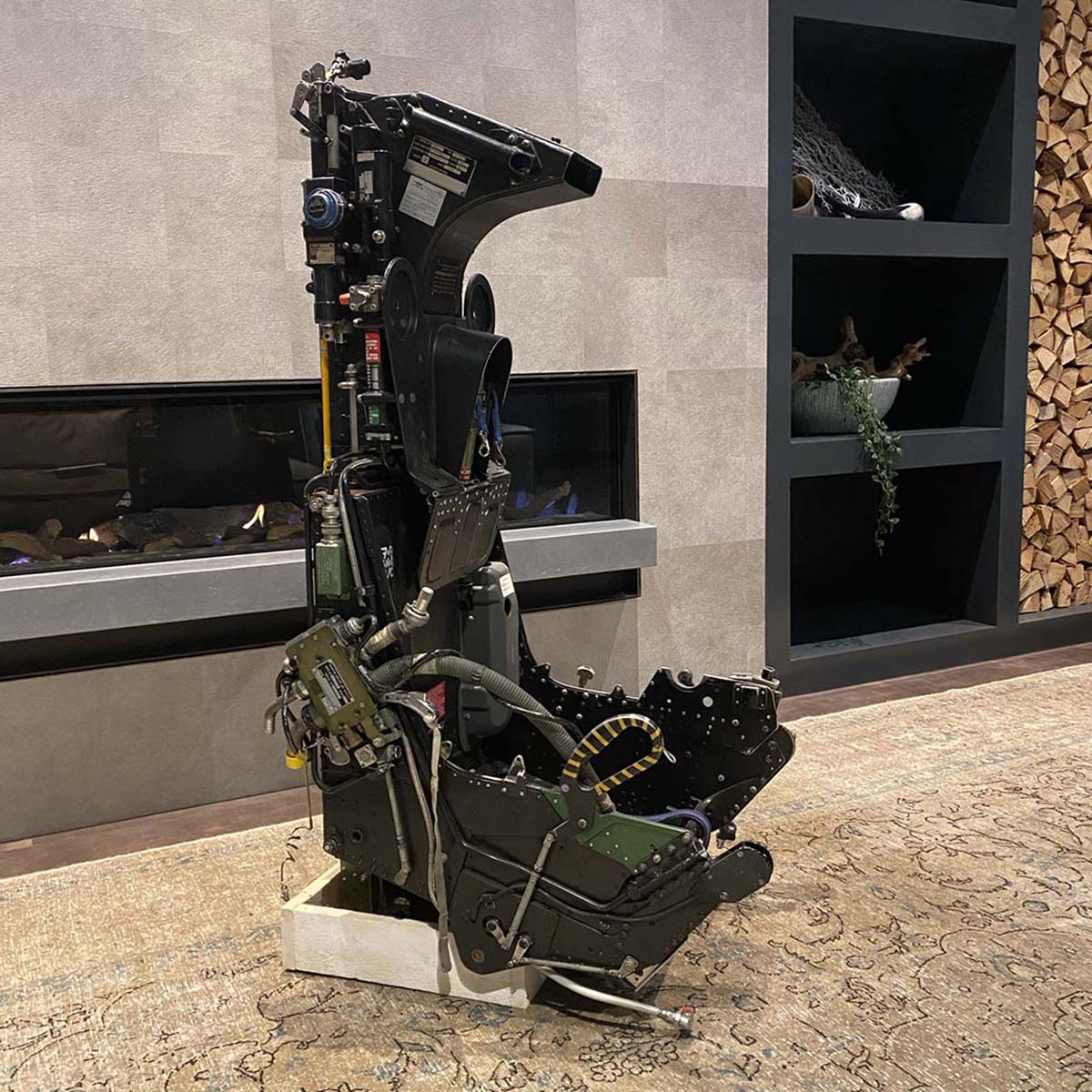 For sale: Martin Baker ejection seat in front of a fireplace.