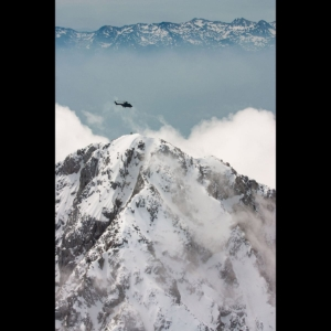 Slovenian Air Force Cougar hovering over the Alps