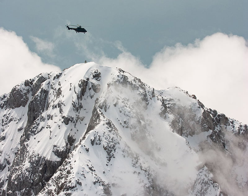 Slovenian Air Force Cougar hovering over the Alps photo