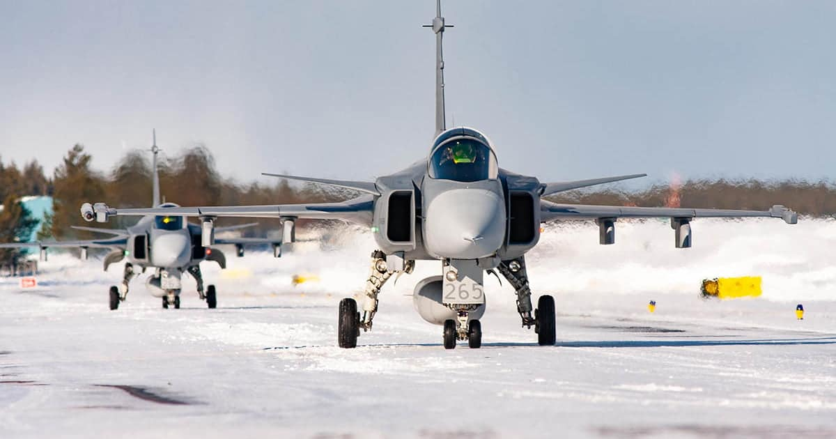 Swedish Air Force Gripens taxiing out in the snow photo
