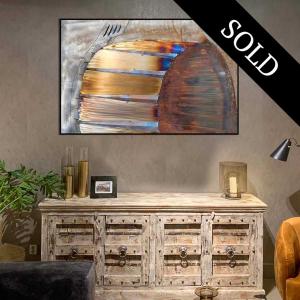 Steel artwork over a cabinet.