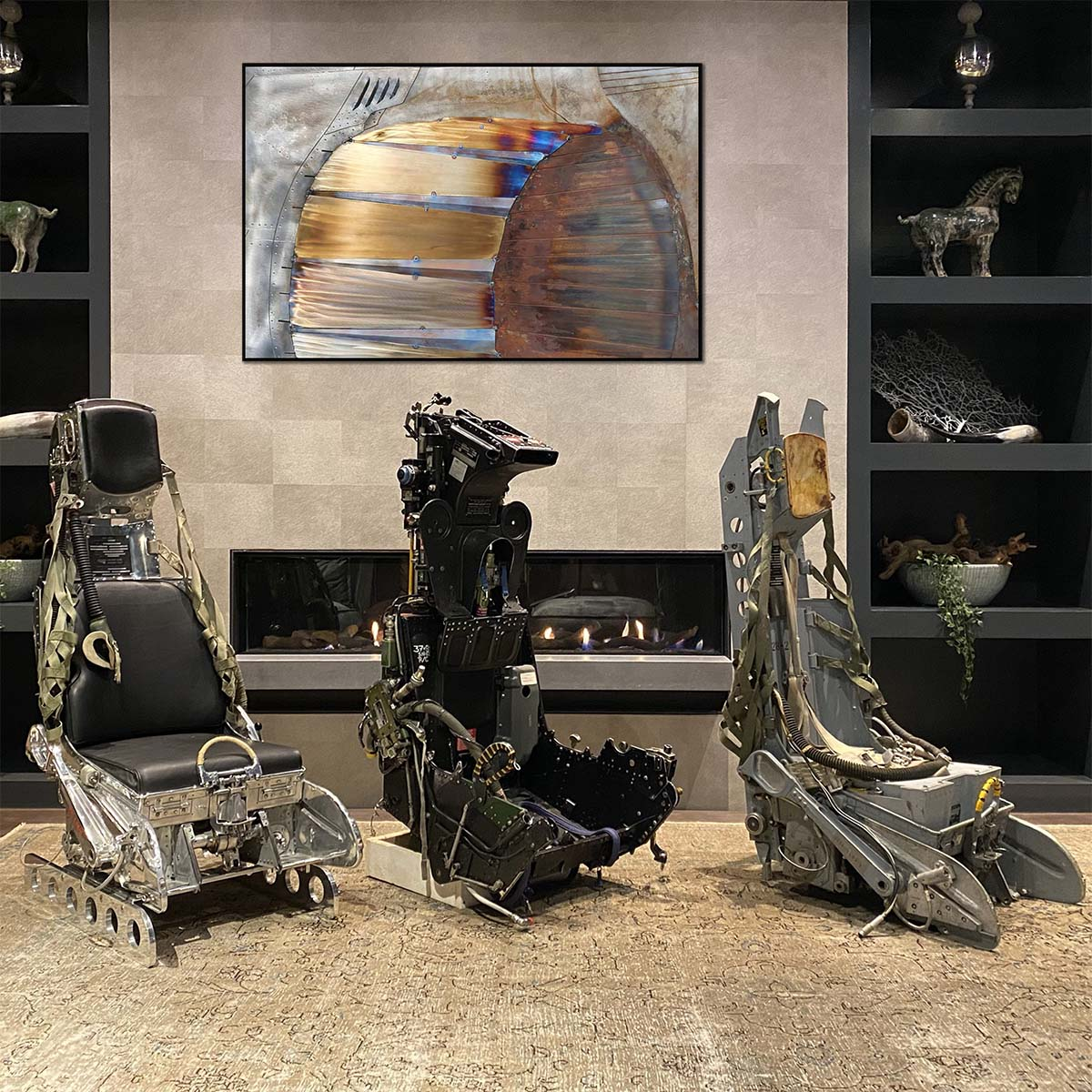 Three ejection seats and our steel aviation artwork.