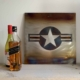 United States Air Force steel roundel artwork next to some bottles on a shelf.