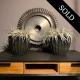 Lyulka AL-21F3 engine compressor stage rotor as a decorative piece in a living room.