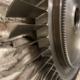 Detail of a Lyulka AL-21F3 engine compressor stage rotor against a brick wall.