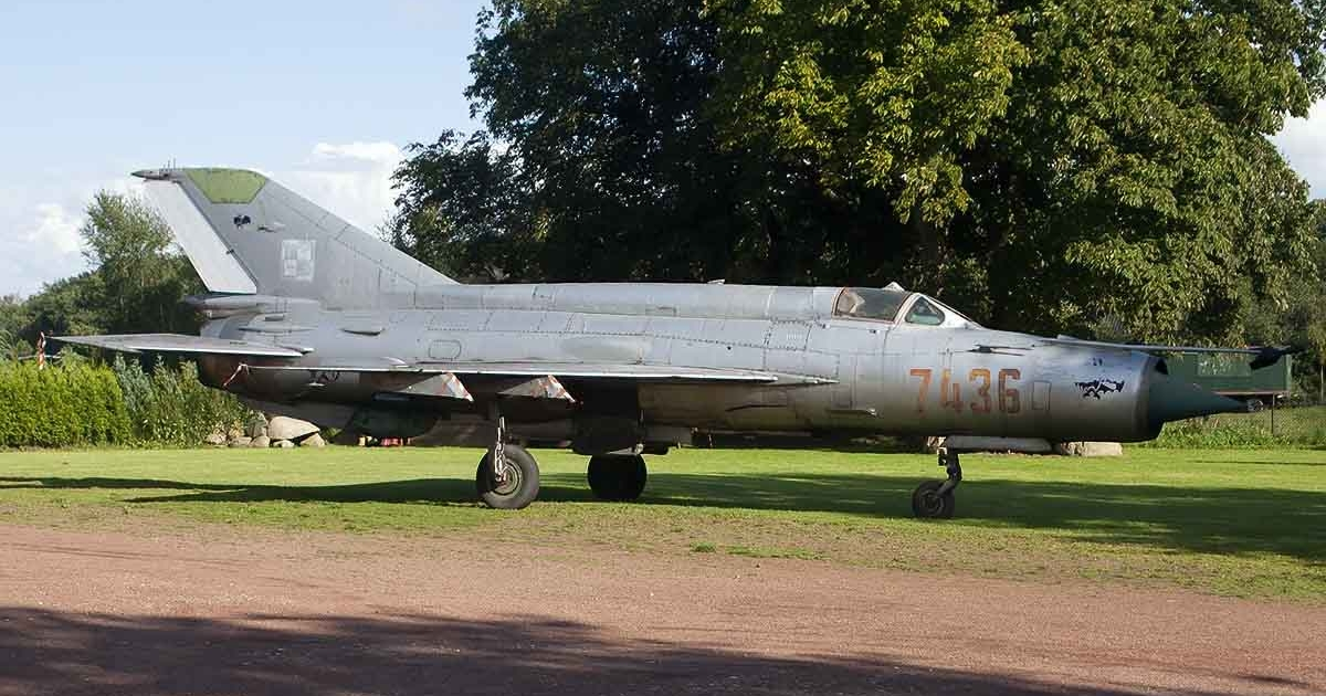 Polish Air Force MiG-21M Fishbed parked on a lawn.