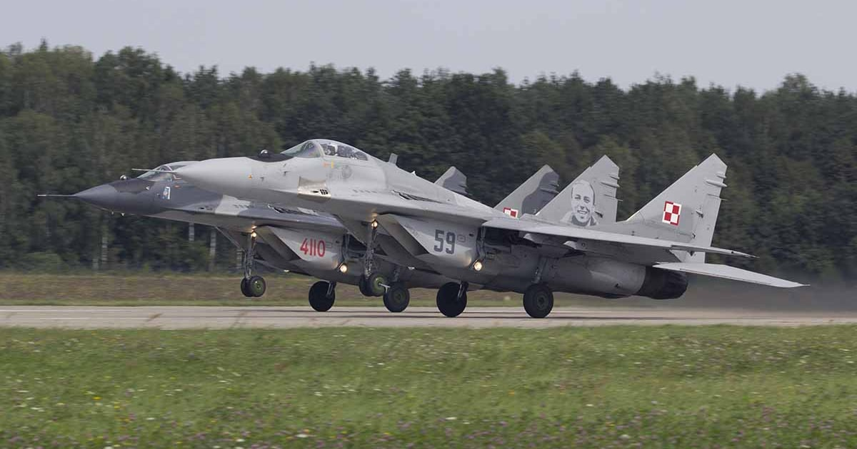 Two Polish Air Force MiG-29s taking off.